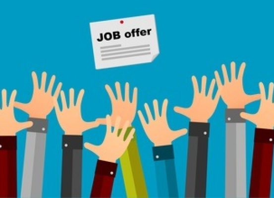 Hands reaching for a job offer posting