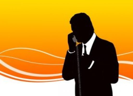 Silhouette of business man speaking on the phone