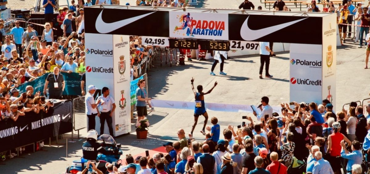 Runner completing a race and crossing the finish line in first place