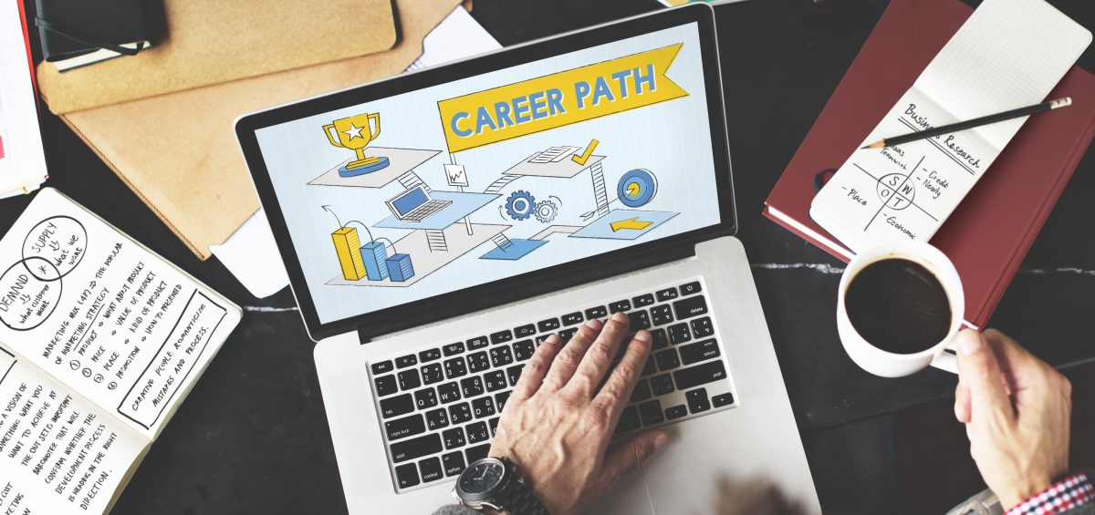 Career Path Employment Human Resources Work Concept. Man at laptop with the words career path in a graphic on his screen