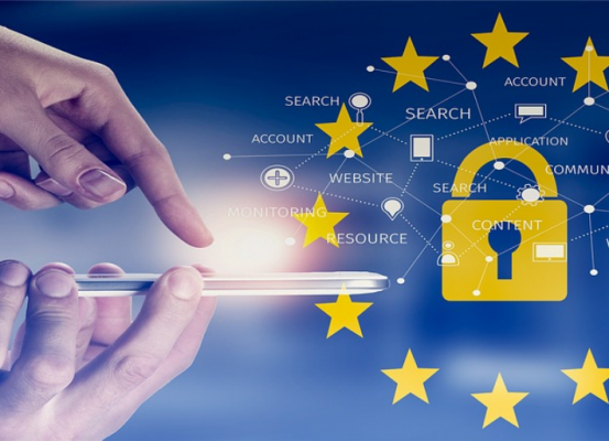 Persons hand touching a tablet next to a symbol of the European Union's (EU) General Data Protection Regulation (GDPR) logo