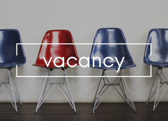 Row of 4 empty chairs with the word vacancy splashed across them