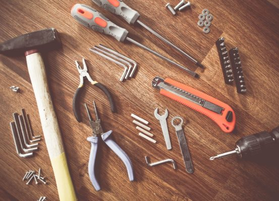 A variety of tools on a work bench