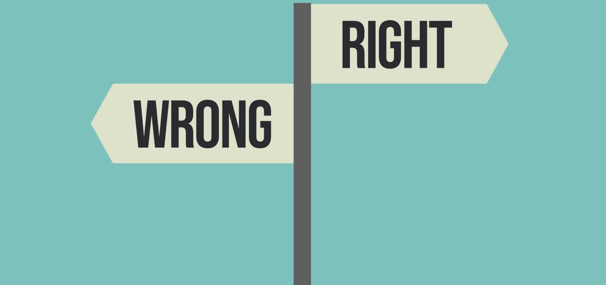 to road signs pointing opposite directions reading right and wrong